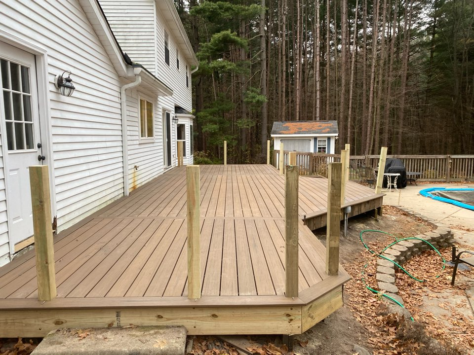 Brighton, MI -  A successful day working on another Toasted Sand Trex deck, coke summer time this will be the perfect place to hang around the pool! Back at it on Monday!