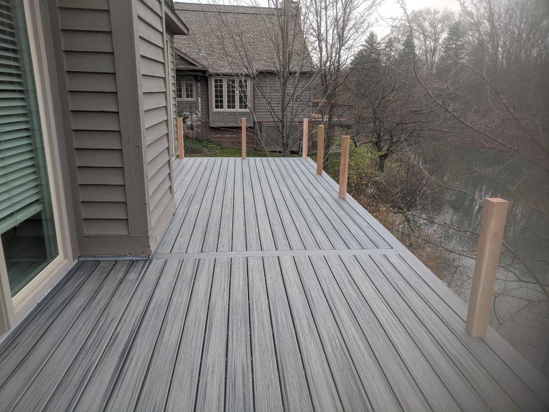 Ann Arbor, MI - Old wood condo deck  to new trex with cedar rails