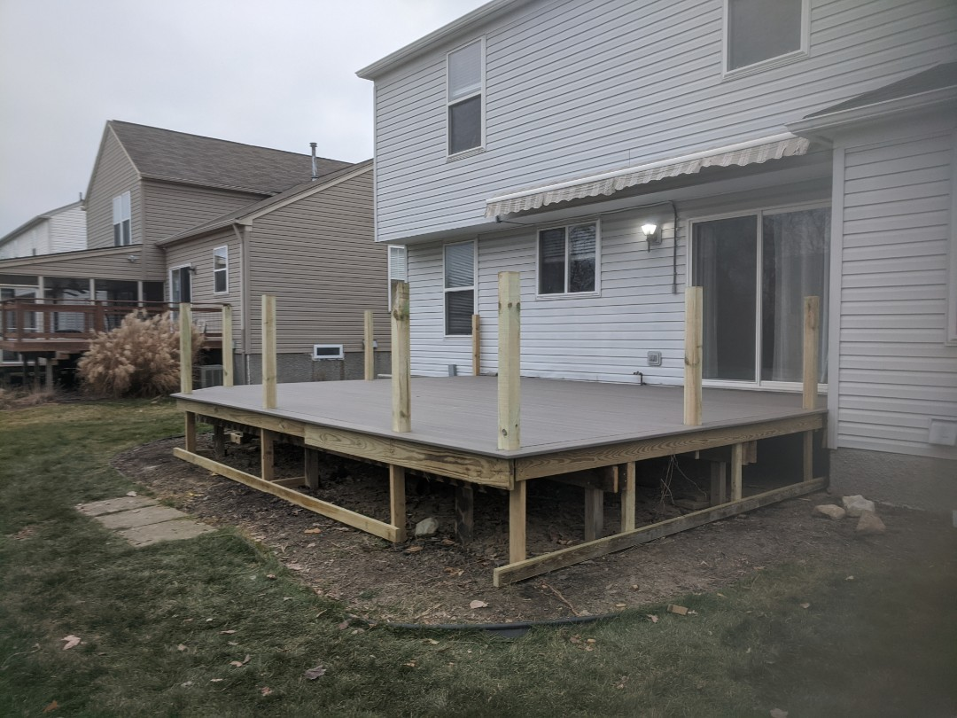 Superior Charter Township, MI - Day one of the transformation from old wood deck to a new trex deck and rails with skirting