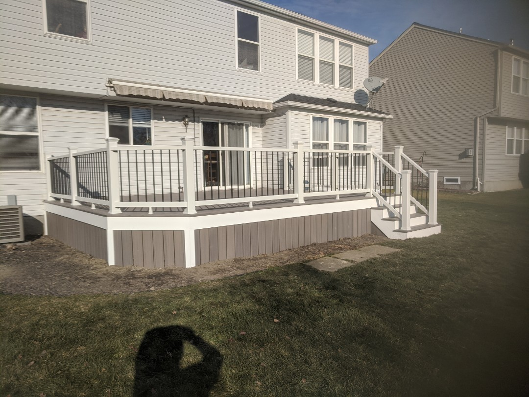 Superior Charter Township, MI - From a old wood deck to a Beautiful trex deck with select rail  and skirting on the sides to keep animals out