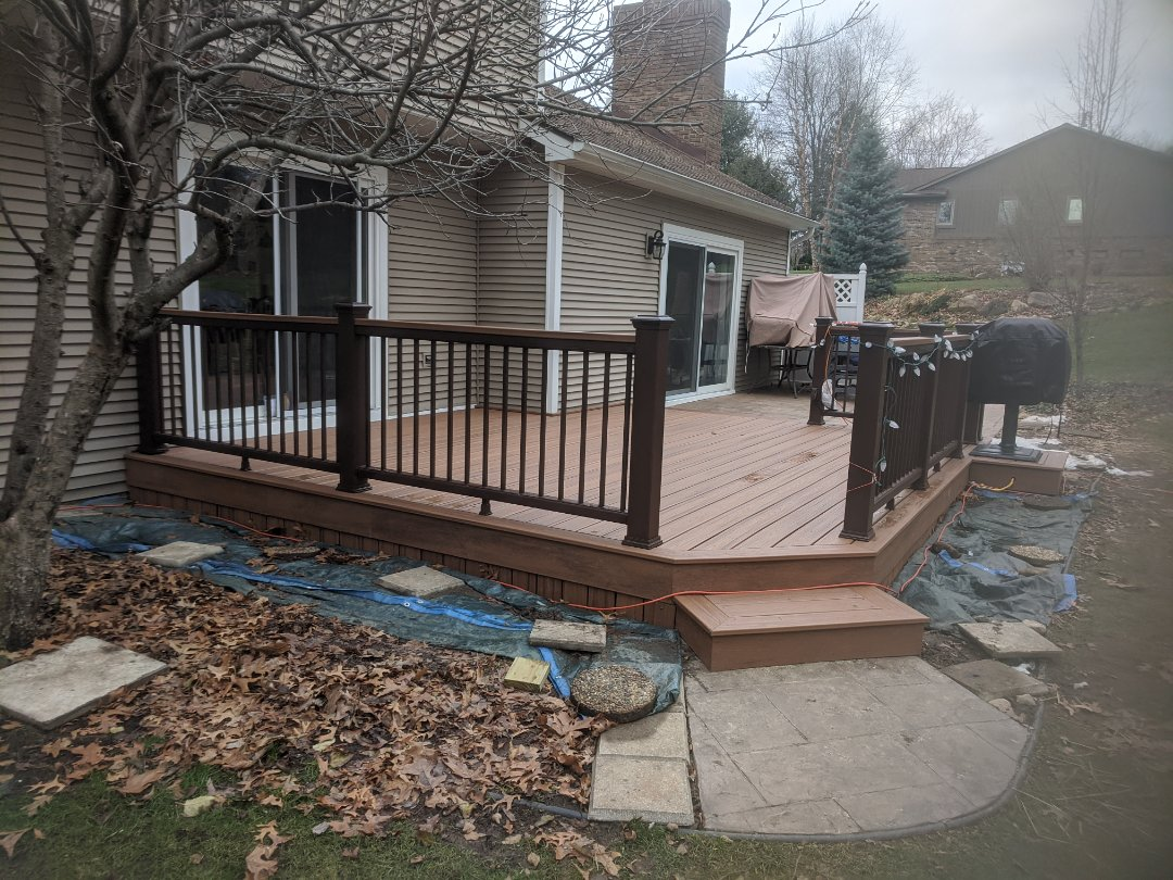 Brighton, MI - Removed a old wood deck put in a brand new beautiful Trex tiki torch decking  with beautiful transcend rails who is next