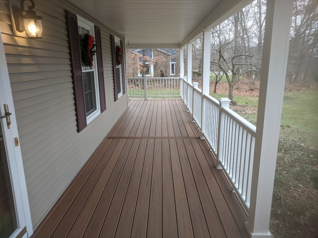 Brighton, MI - A old wood porch transformed into new beautiful trex with white transcend rail