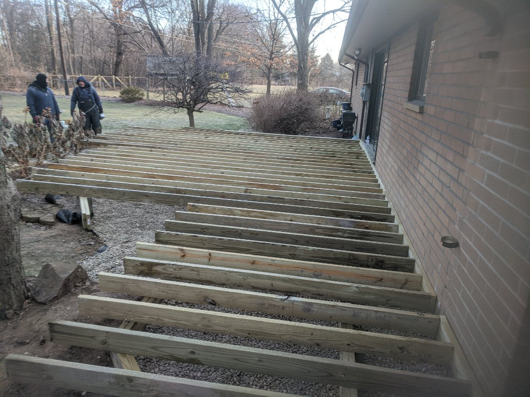 Livonia, MI - First day of transformation of an old wood deck to a new one with Trex decking and aluminum rail and it does not matter what time of year winter or summer