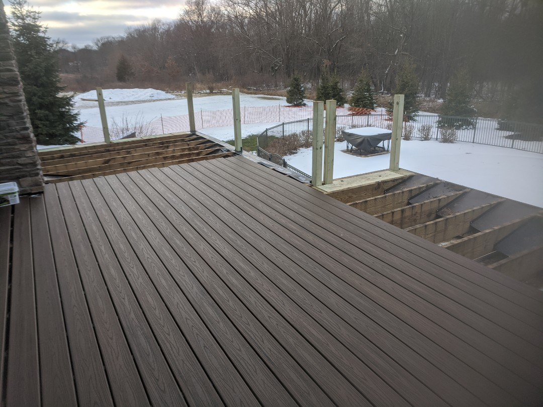 Howell, MI - Day two all post set half trex decking down  starting to look like a beautiful deck