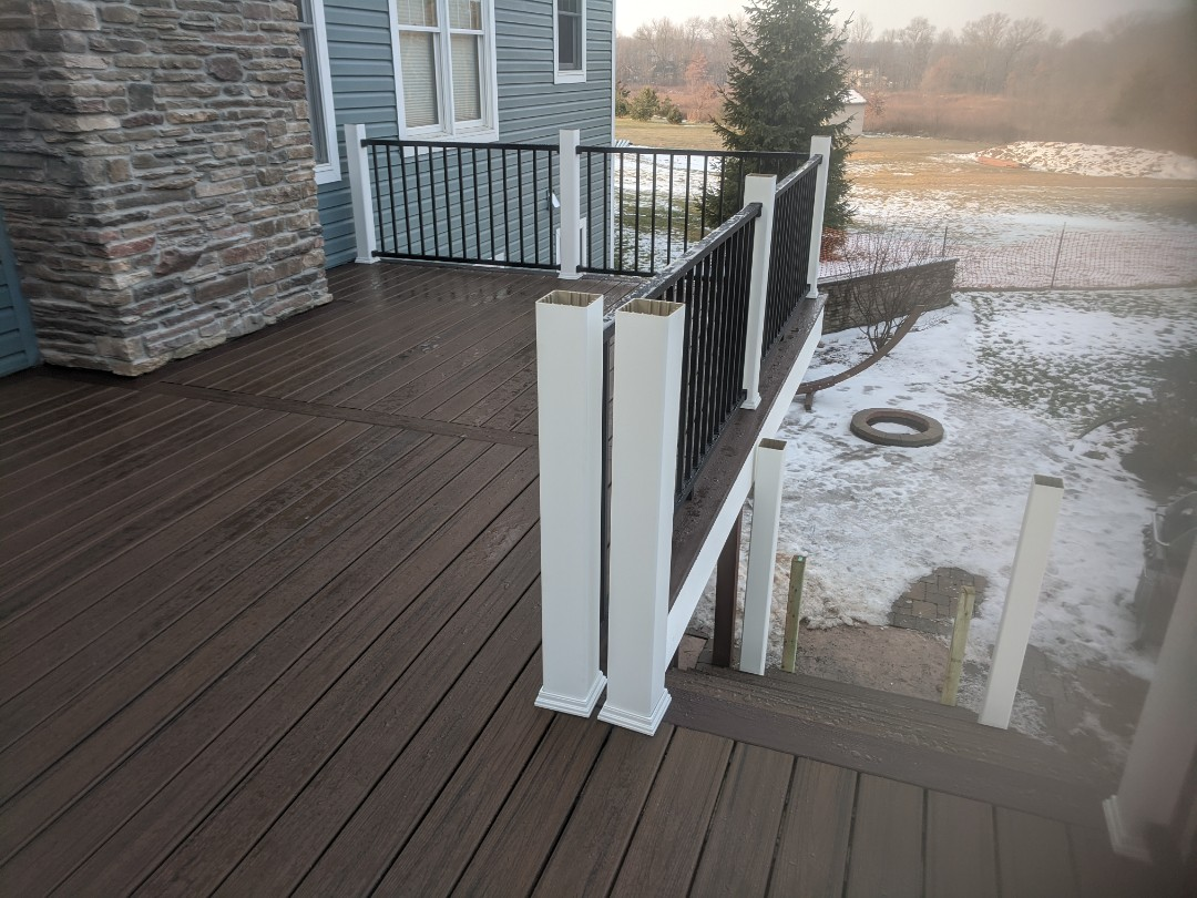 Howell, MI - One more day to finish a beautiful trex deck with signature rails