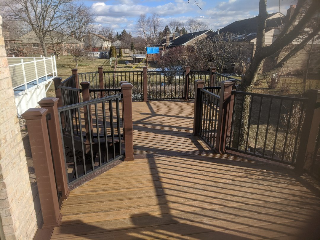 Livonia, MI - Another beautiful trex deck with signature rails and havana gold decking this one took 4 days start to finish in middle of January who is next