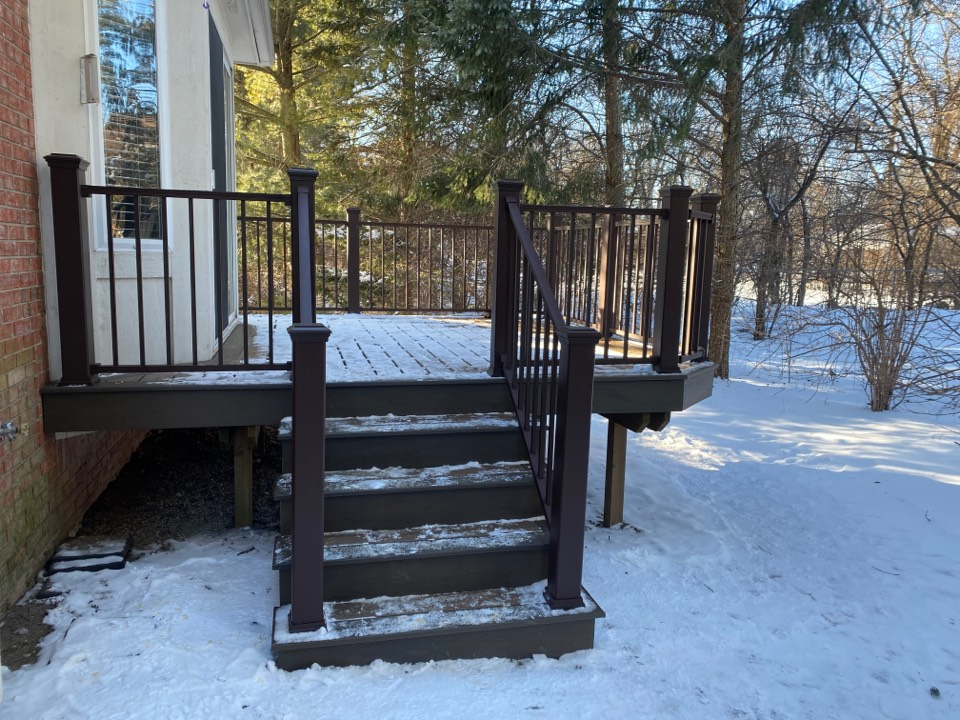 One of four Trex Decks that were are installing in this condo complex! We are still building during the winter!