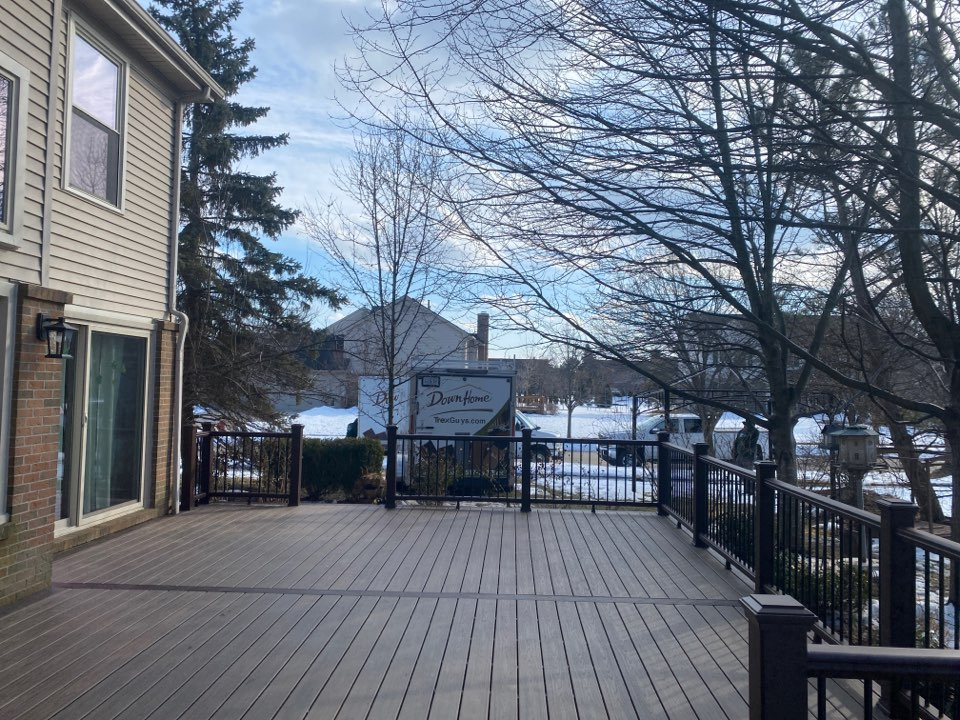"""Another gorgeous Trex deck installed in Canton MI! Spiced Rum decking and vintage lantern border! Worked in 8"""" son and then 50°F."""
