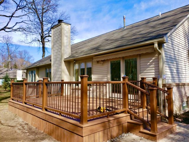 Plymouth, MI - ThIs deck was a pleasure to work on, our crew finally had some nice weather to work in. This deck features Trex Tiki Torch decking, fascia and skirting. The rail systems are Trex Transcend Tree House, with bronze balusters. This was a great way to kick off the spring deck building season.