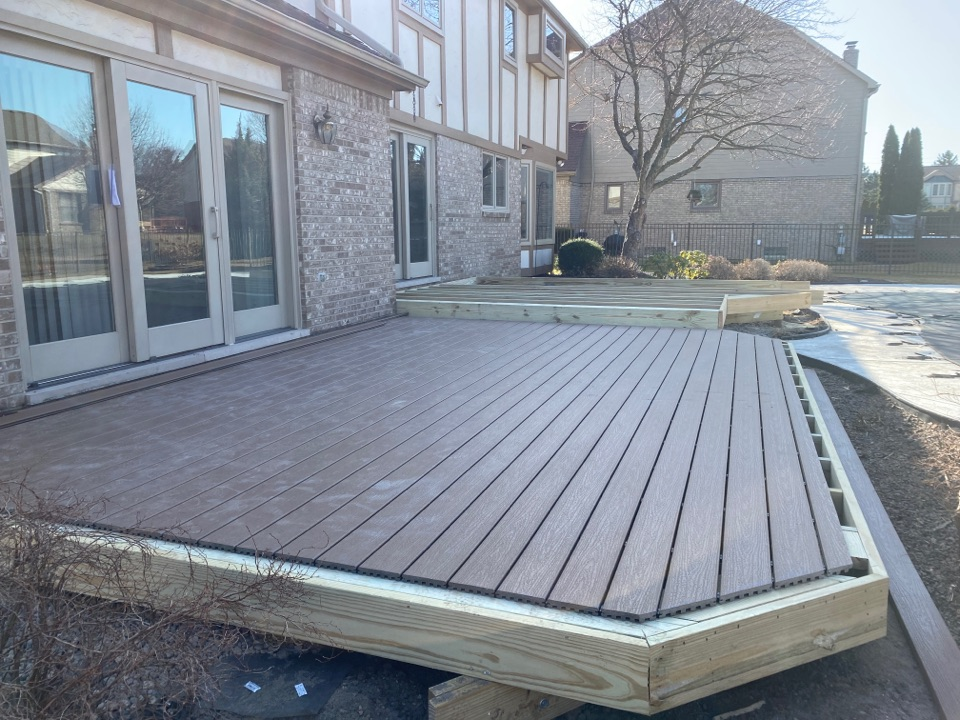 Livonia, MI - Made a lot of progress on this multi-level Trex deck today! This one is going to look amazing when it's done!