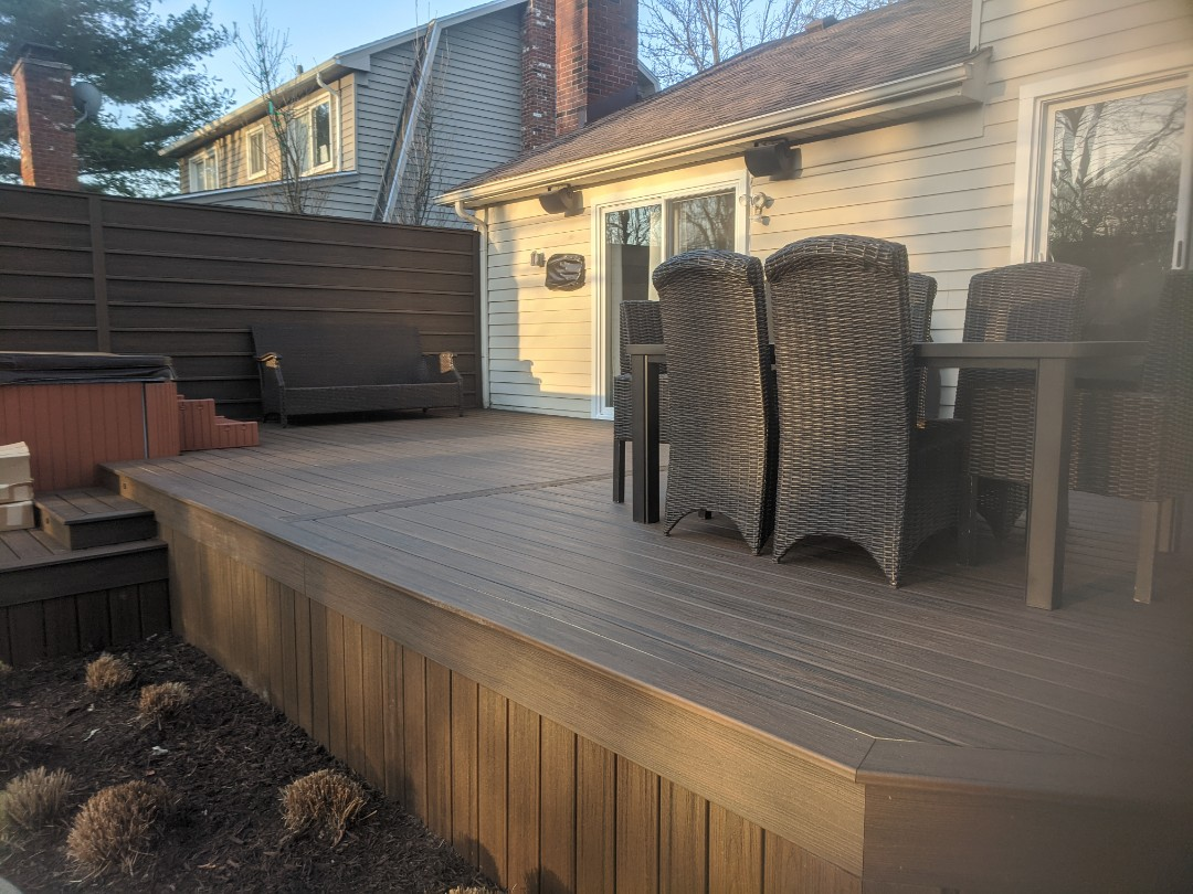 Livonia, MI - A beautiful spice rum deck in livonia with trex privacy rail just waiting on the cable rail