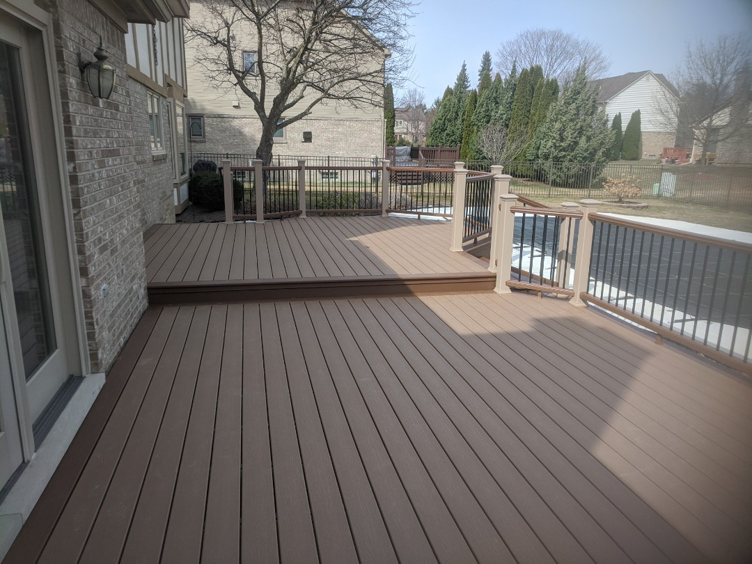 Livonia, MI - Another  beautiful beach dune and saddle trex deck here in livonia
