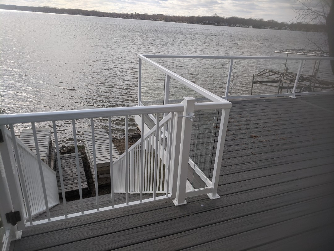 Pinckney, MI - A beautiful trex deck on portage lake with glass rails all ready for summer