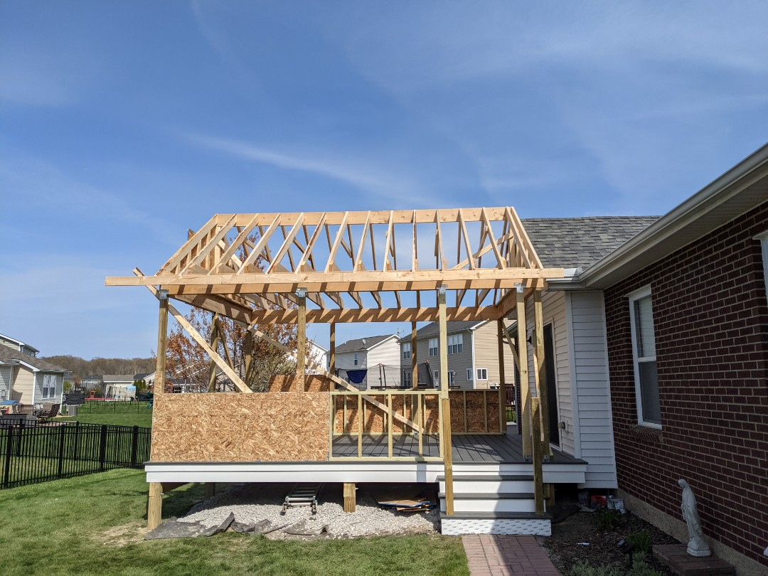 Flat Rock, MI - Day three small walls and rafters r up next plywood and overhangs
