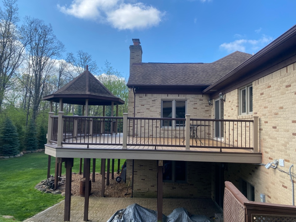 Bingham Farms, MI - Just finished up this multi-toned Trex Transcend deck! This one turned out amazing. We were able to keep the existing gazebo and wrap the post in Trex Tanscend Post sleeves!