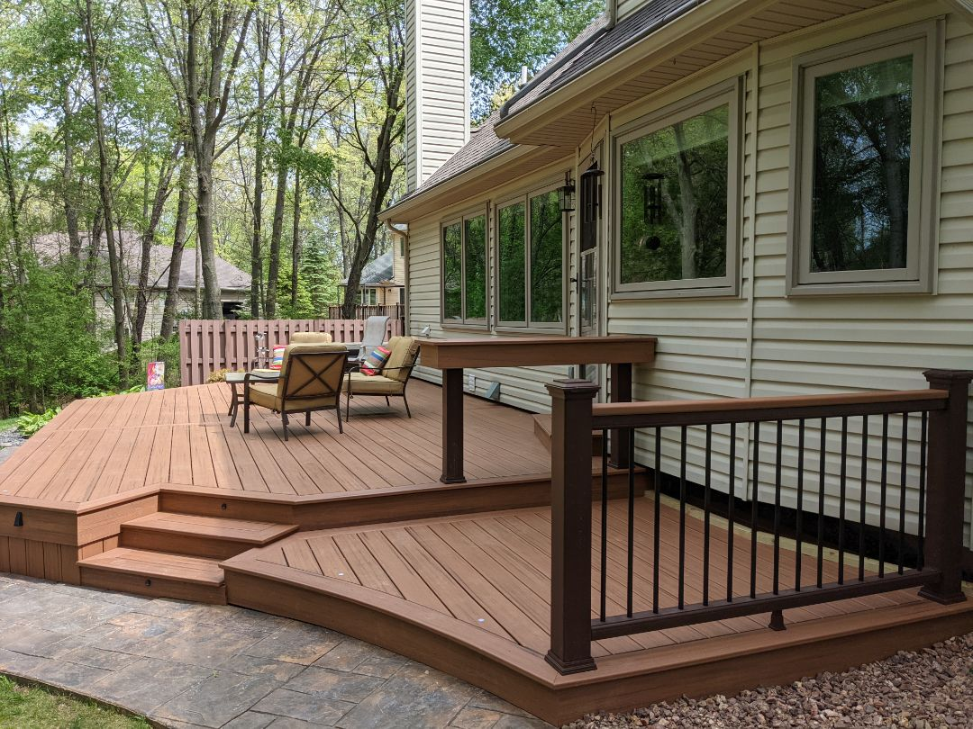 Howell, MI - A beautiful transformation from old wood deck to beautiful tiki torch decking and skirting in  Howell