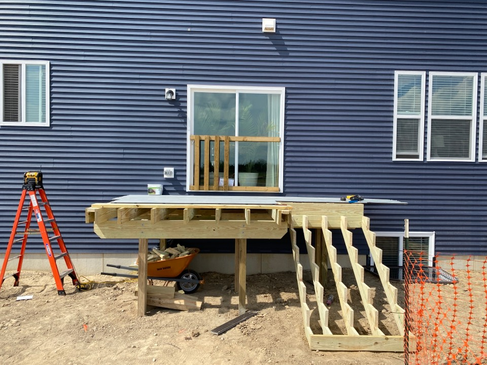 Howell, MI - A lot of progress made on this deck that we started at noon today! This one will over look the home owners soon to come pool and allow them easy access!