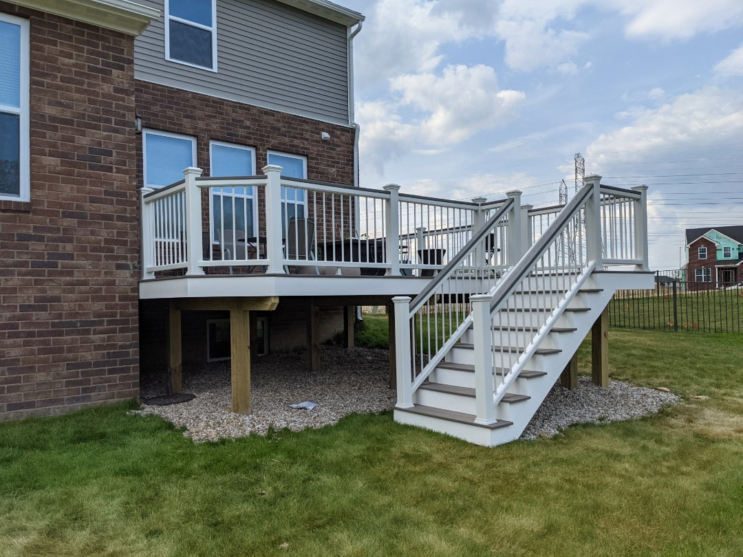 Canton, MI - A beautiful clam shell deck with white cocktail rail  in Canton