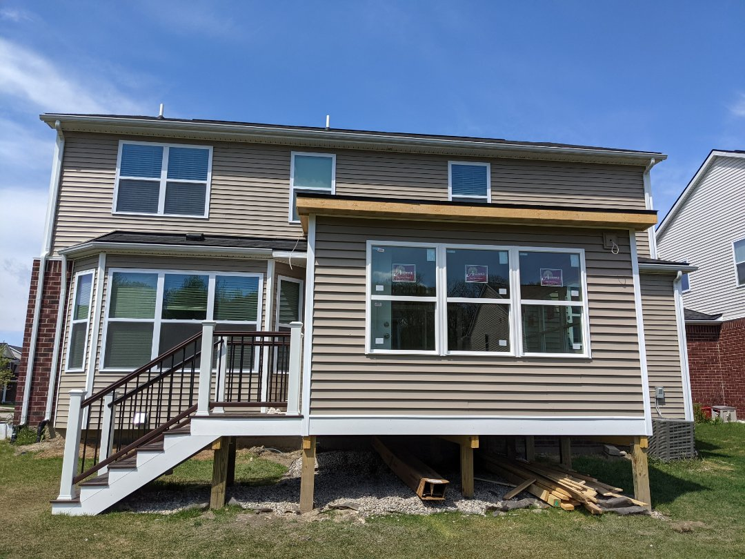 Canton, MI - A beautiful new covered porch with Trex decking  and vinyl siding