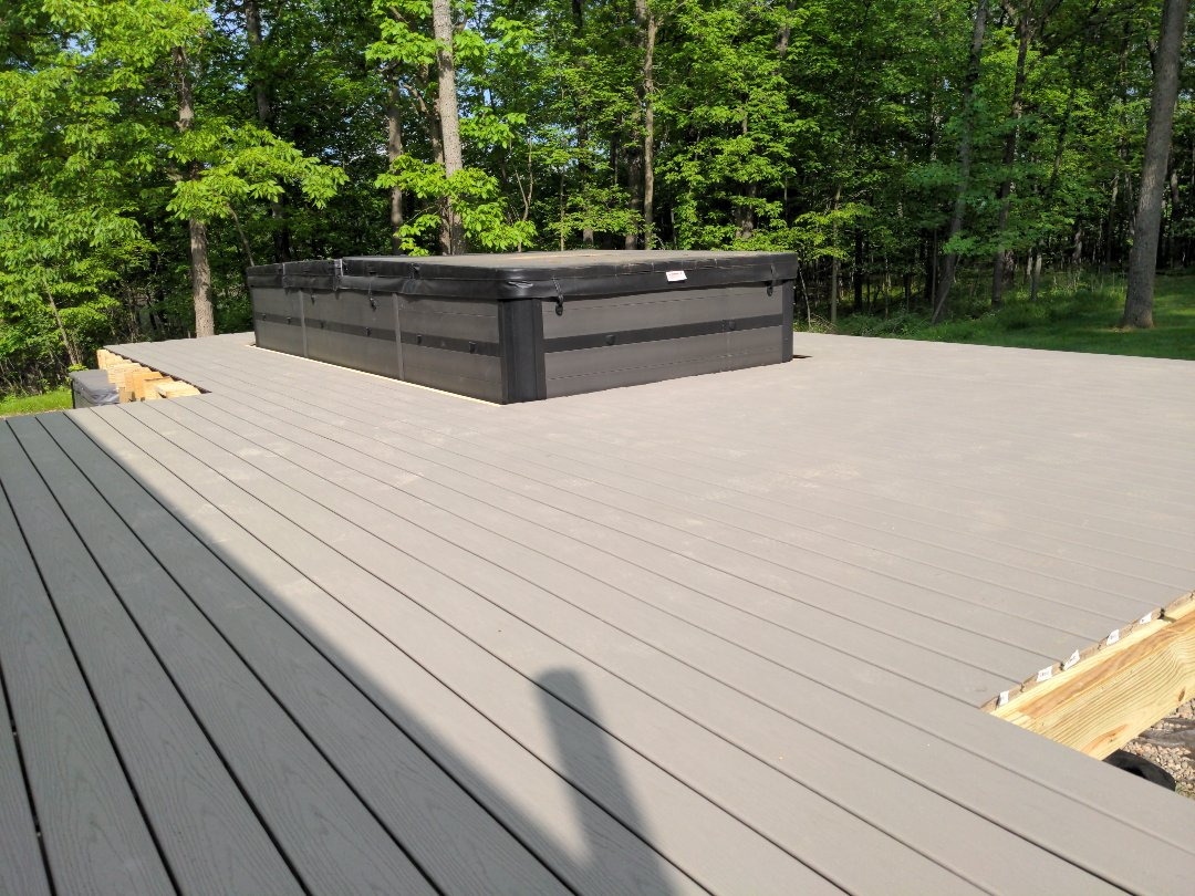 Day two of the deck we have it decked with gravel path Trex tomorrow border and maybe rails