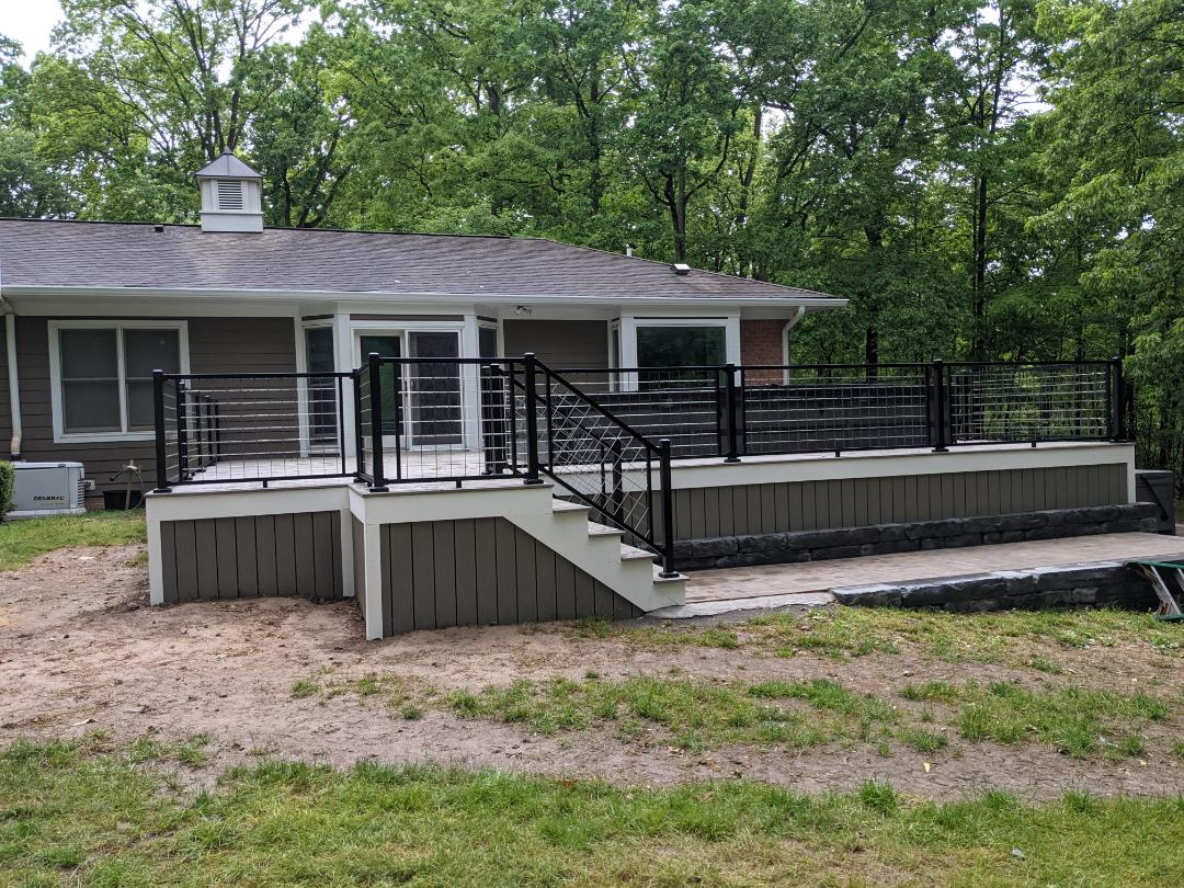 A beautiful Trex deck with azek trim and signature mesh  rail in south lyon
