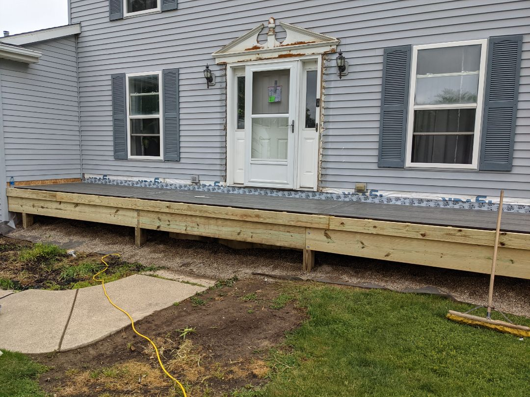Howell, MI - Day one start from old small porch to a long covered  Trex porch