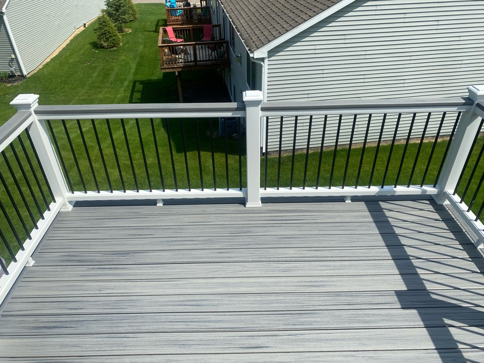 Howell, MI - Just finished this beautiful walkout Trex Deck! The colors consist of Island Mist and White Transcend railings!