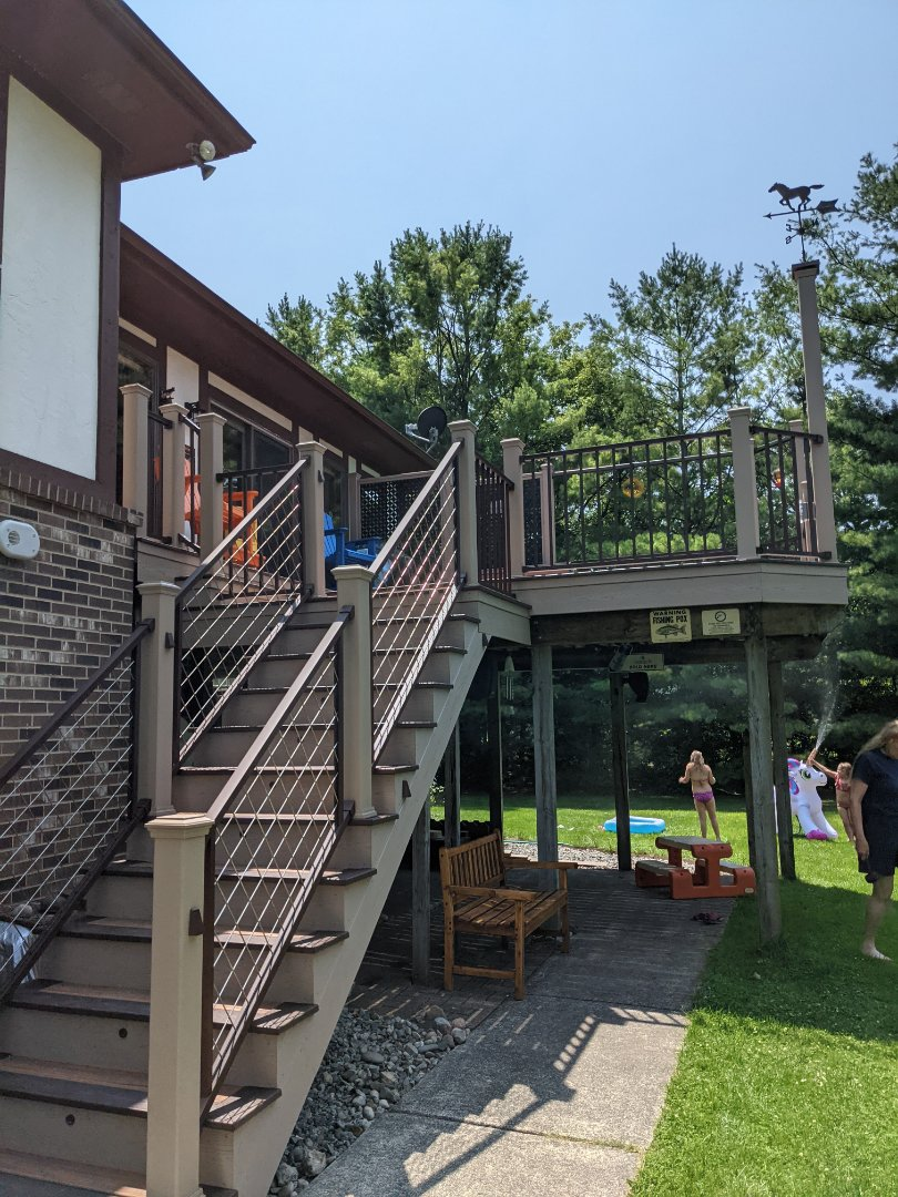 Plymouth, MI - Beautiful new trex deck with aluminum rail and privacy rail