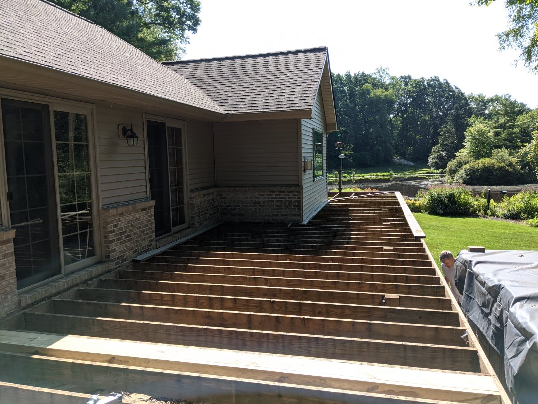 Howell, MI - Start of a new tear out and retop of a old wood deck deck to a new trex deck in Howell