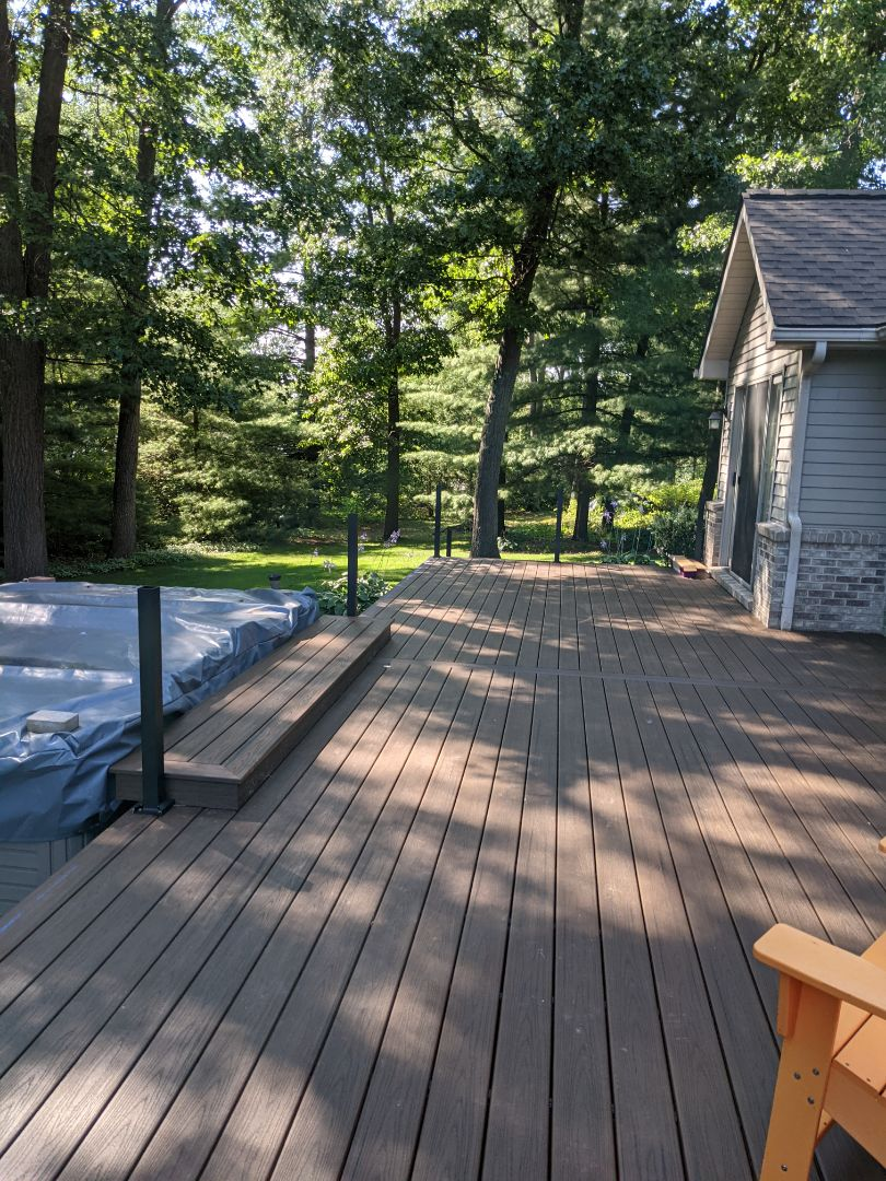 Howell, MI - Decking finished on both decks stairs in select rail post started almost there