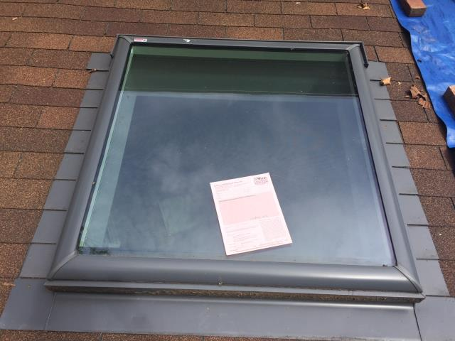 Fairfax, VA - Skylights in the sunroom were leaking, so we installed new flashing to seal them up.