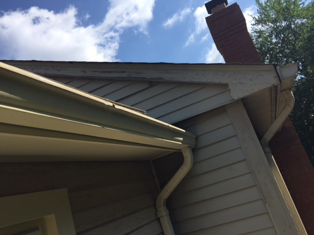 Fairfax, VA - This gutter was not draining properly, so we reset it to make water flow toward the downspout and installed new hangers to secure it.