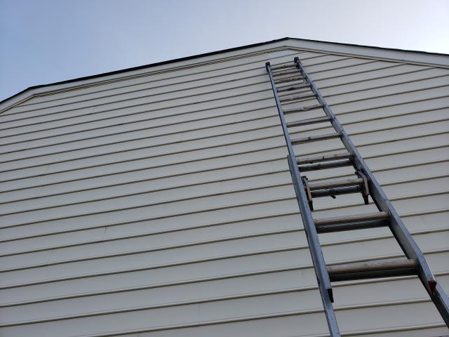 Woodbridge, VA - Just one piece of siding needed to be replaced on this home.  It was a tall order, but we were up to the task!
