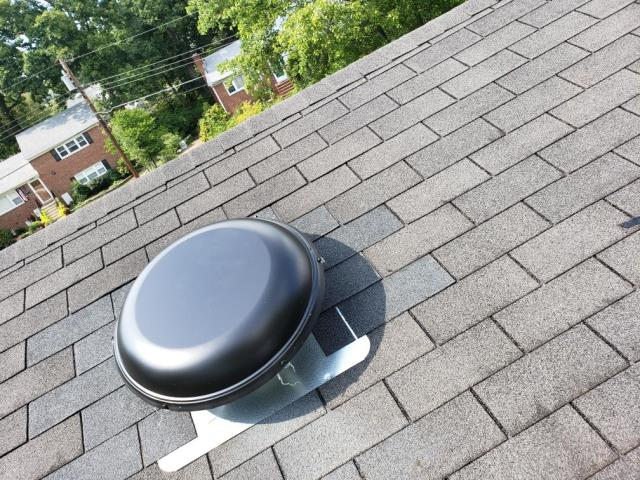 Alexandria, VA - We replaced two attic fans for this homeowner, and replaced the shingles surrounding them. While we were up there, we replaced more damaged shingles and the flashing on the chimney, too.