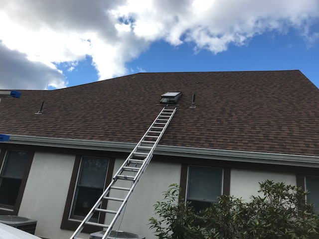Warrenton, VA - We replaced the old, leaking skylight with a Velux manual fresh air skylight and installed new flashing. We replaced the surrounding shingles using Landmark Burnt Sienna.