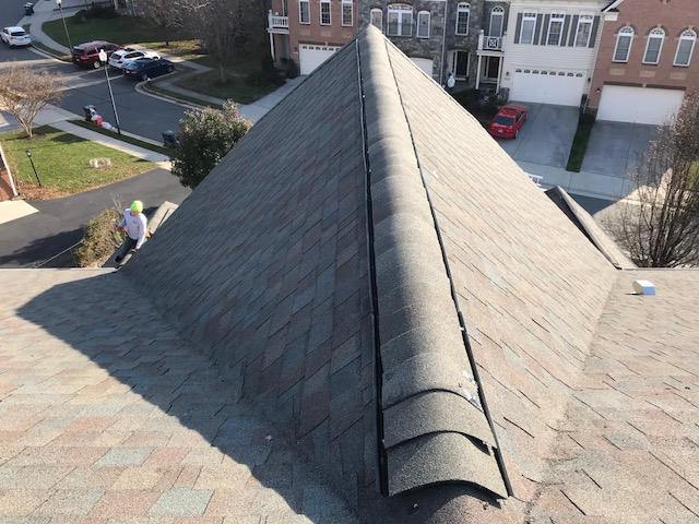 Sterling, VA - We removed the old aluminum ridge vent and installed new shingles over the ridge vent. Then we added hip and ridge caps over the newly-installed shingle ridge vent.