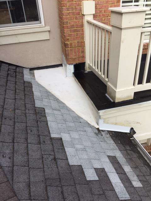 Fairfax, VA - This homeowner reported a leak where the portico connected to the house.  We removed the low-slope shingle cricket and installed a HD insulation board, then a white TPO membrane. We fabricated and installed white aluminum counter-flashing for the portico trim transition and sealed all flashings. Problem solved!
