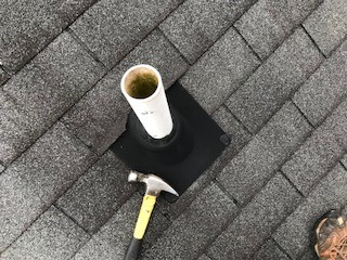 Fairfax, VA - The roof tune-up for this customer included replacing an old pipe collar, as well as resealing all flashings and nail pops and replacing shingles that were the wrong color.