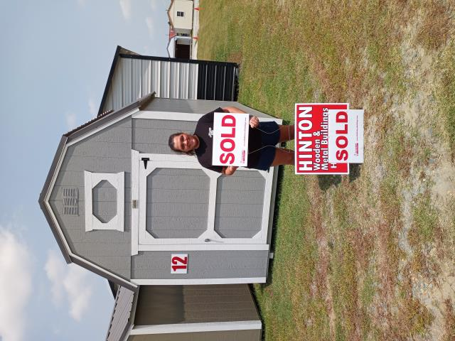 Fayetteville, NC - Ms. Sauceda purchased our 8x12 lofted barn for her home in Fayetteville. If your in Dunn stop by Highway 55 and grab lunch. Thank you for choosing Hinton Buildings.