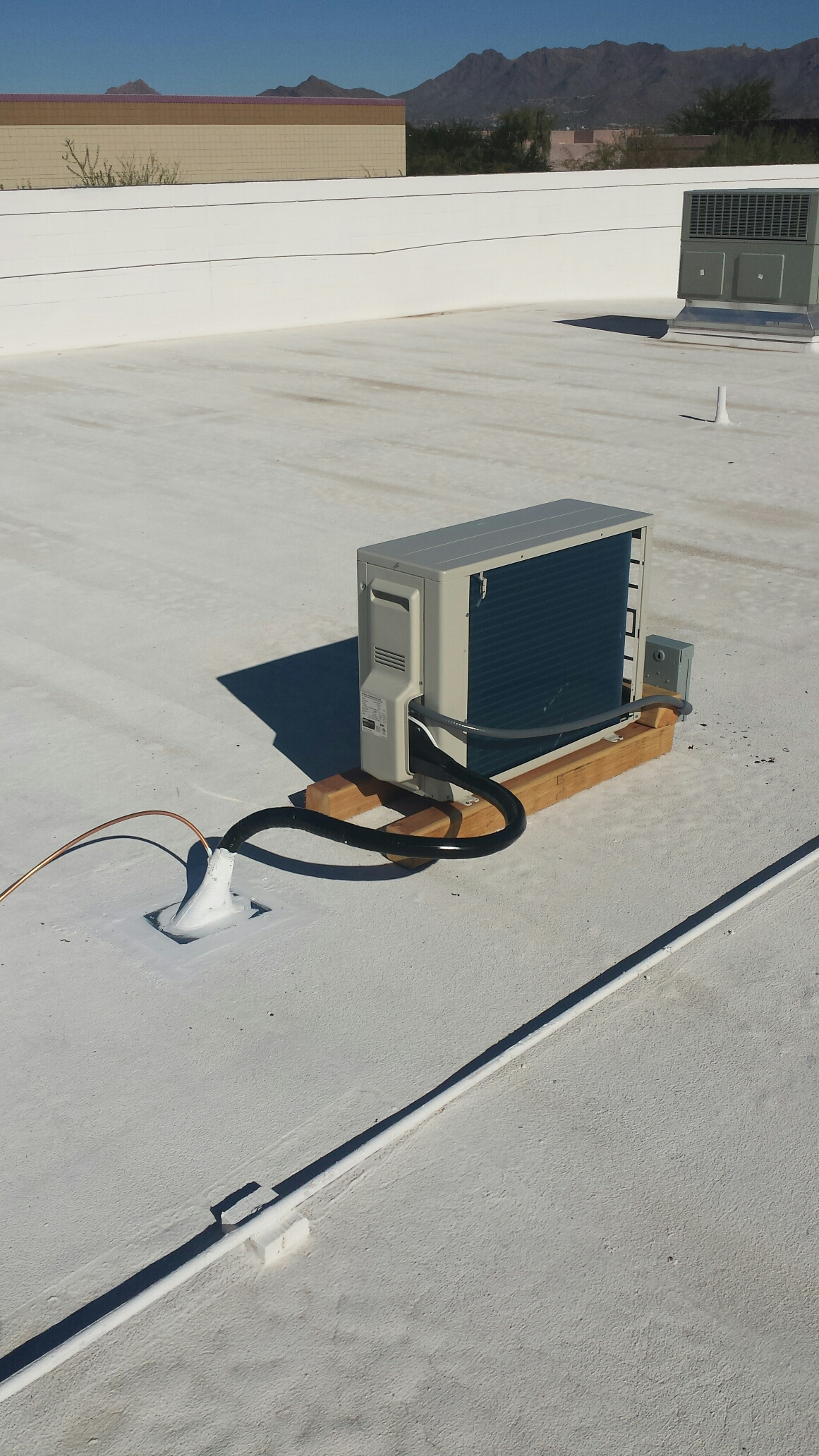 Scottsdale, AZ - Performing quality control service on new A/C system.