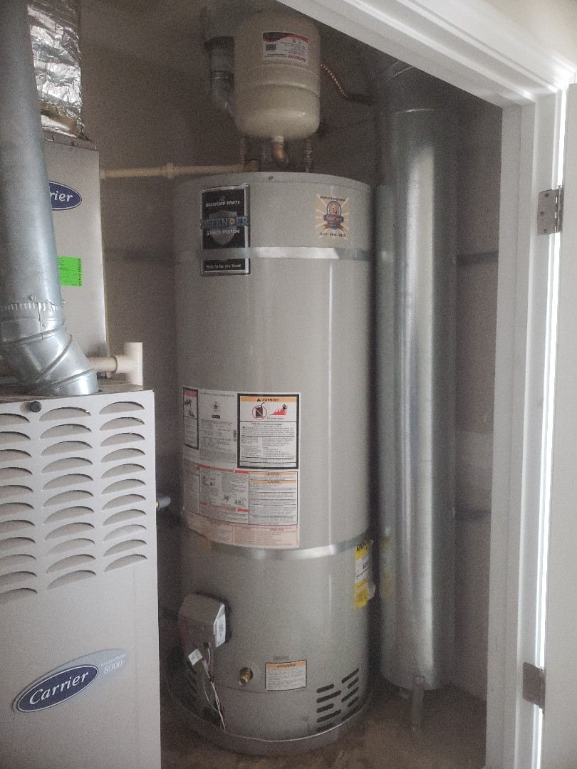 installed new 50-gallon water with all code upgrades expansion tank seismic strapping and CPVC t&p line