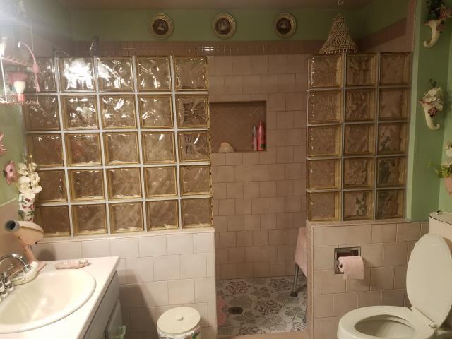 Lakebay, WA - Custom tile walk-in shower in pink.