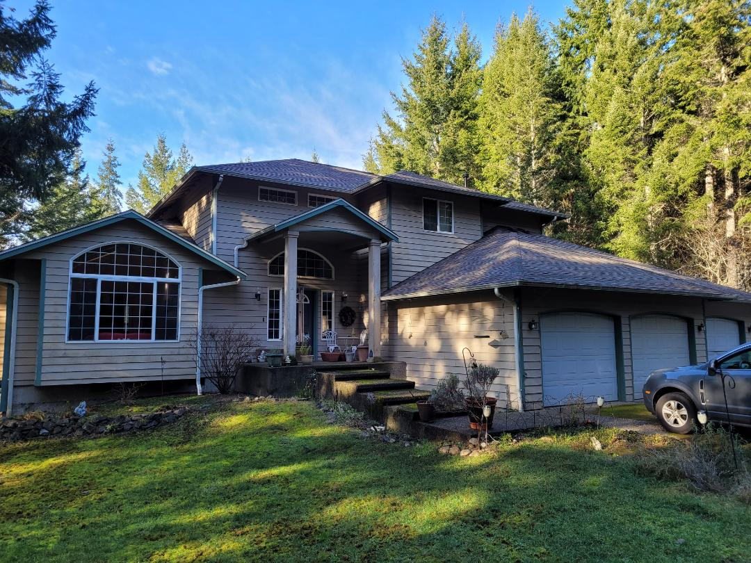 Gig Harbor, WA - 30 Yr Malarkey Next Gen Rubberized shingle system with specialized underlayment.  Lead dead valley. New skylight collars. Heavy perimeter metal. Color-match vents and accessories. Ridge ventilation. Color Heather
