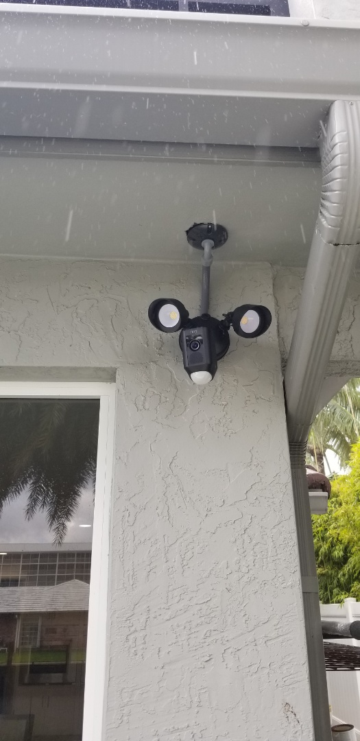 Installing Outdoor Spotlight Camera & Doorbell Camera at Ft Lauderdale residence.  Includes remote notifications of activity.