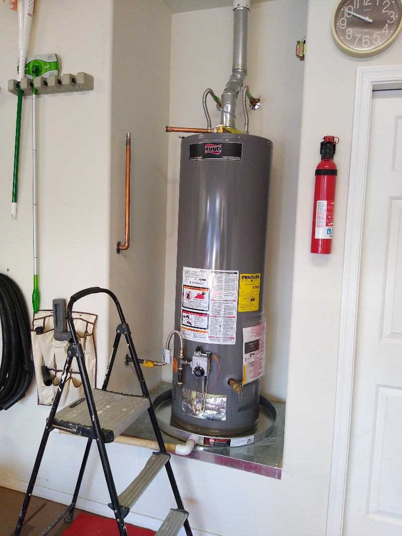 Vail, AZ - Installing new 40 gallon natural gas water heater in home.  Hot water restored to clients.