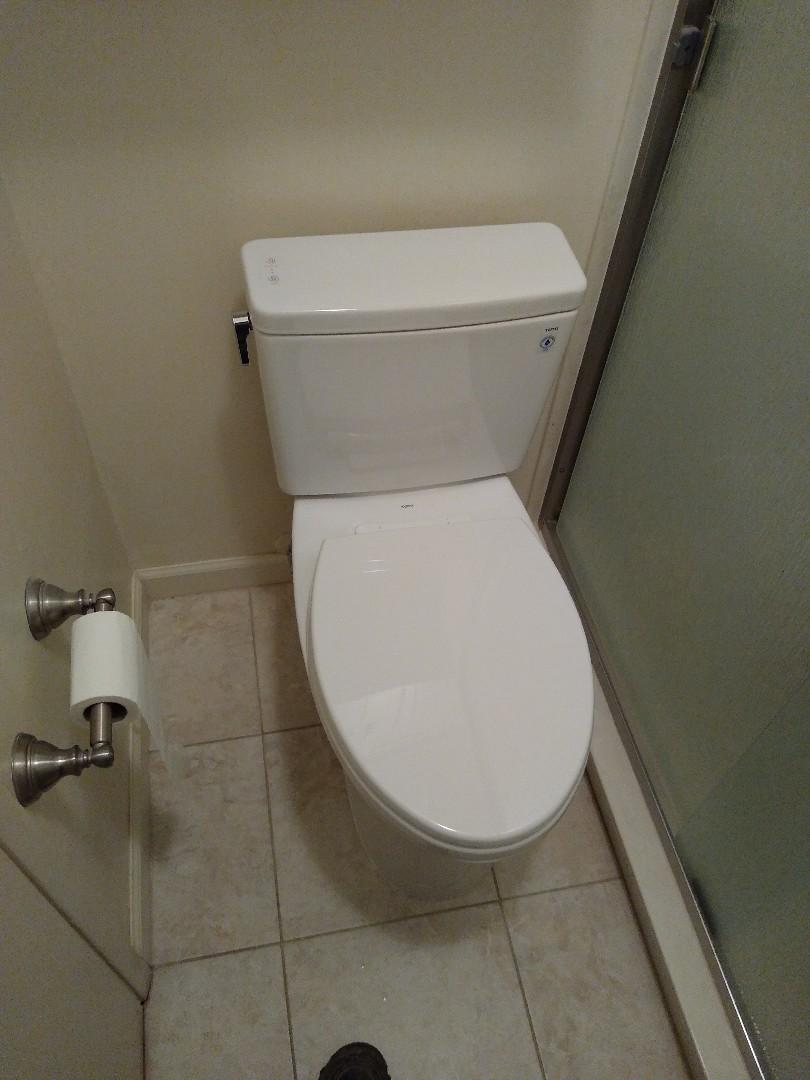 Tucson, AZ - Installing new Toto Drake dual flush toilet.  Tight space, perfect fit.