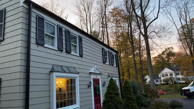 """West Hartford, CT - 6"""" half round black seamless aluminum installation and 4"""" aluminum downspouts."""
