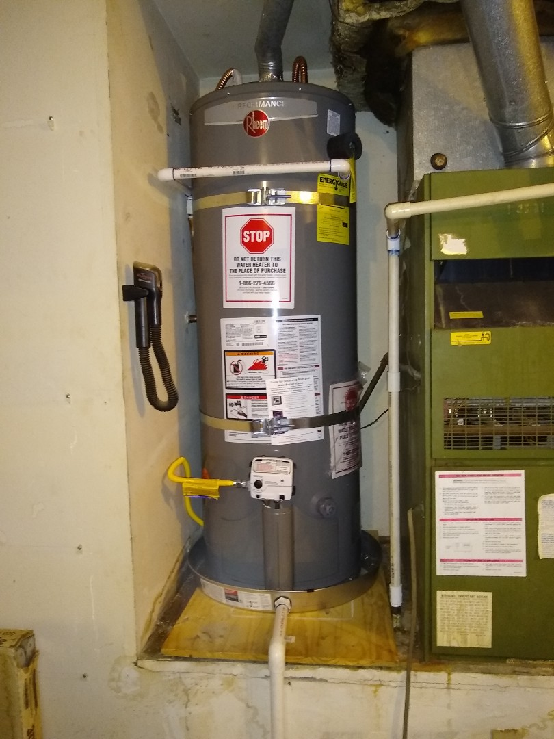 Working on removing and replacing client supplied water heater and parts