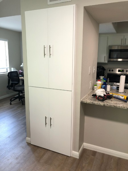 Austin, TX - Do you have an opening and would like to take full advantage of it? Give us a call. Custom cabinet doors installed to close off shelving area.