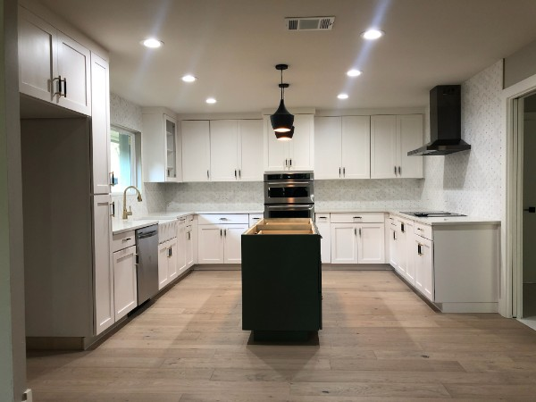 Austin, TX - Let us transform your kitchen: New costume made cabinets, island, and floors. New sink. New backsplash, vent hood and lights